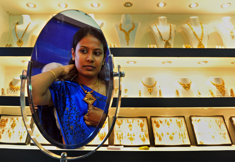 indian-woman-trying-on-jewellery-Manjunath-Kiran129217305.jpg