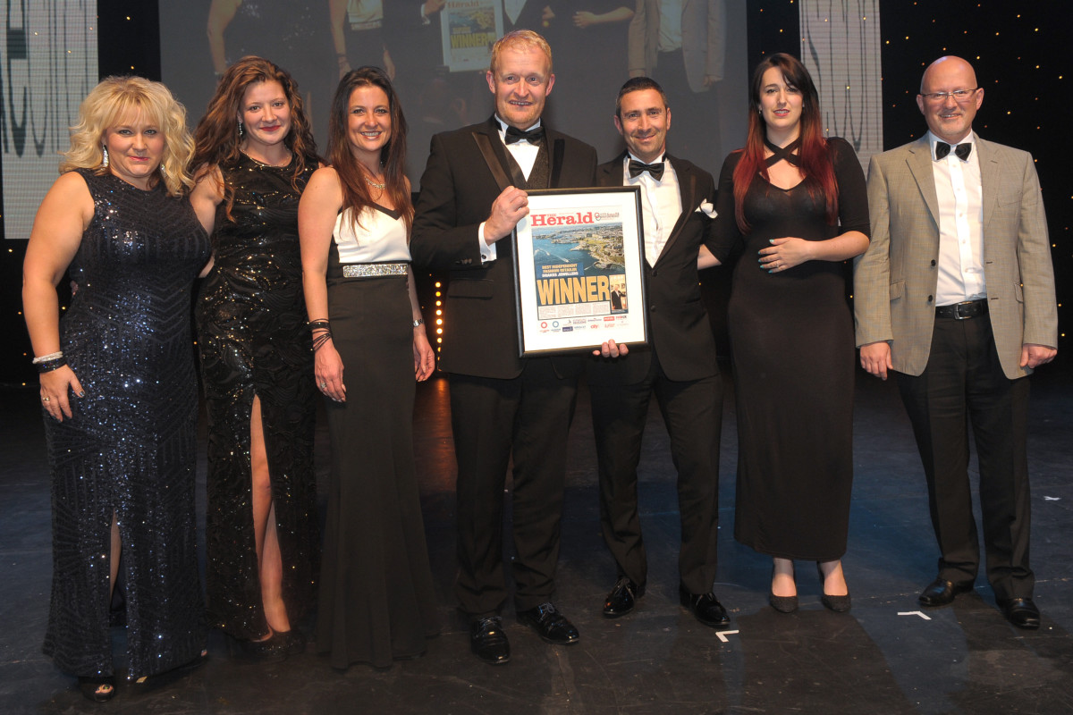 The Drakes Team Collecting their Award